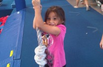 Young Girl at Karate Camp on Rope Swing