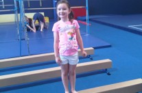 Young Girl on Balance Beam at Karate Camp