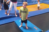 Young Boy on Gym Pads at Karate Camp