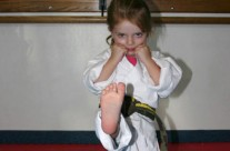 Young Girl Practicing Straight Kicking