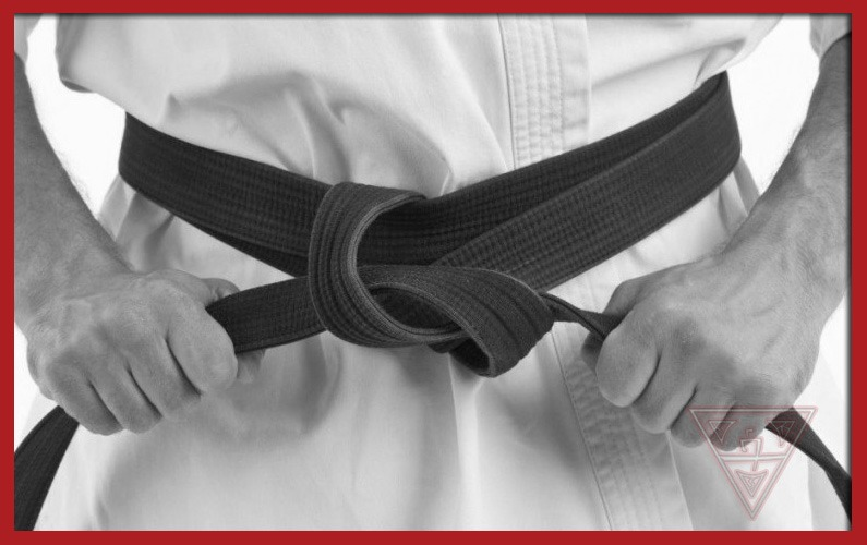 Man Tying Black Belt