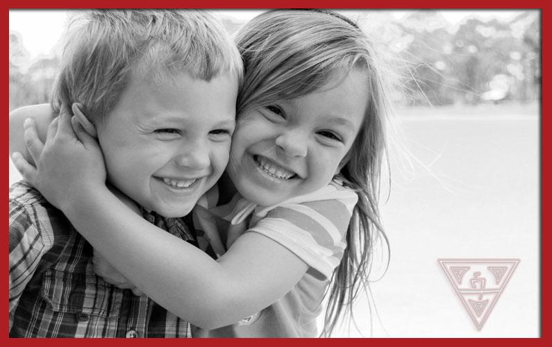 Two Kids Hugging After Having Argument